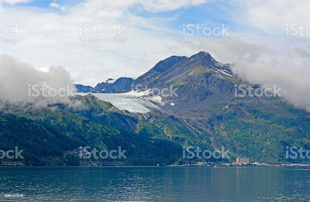 Glacier above a Coastal Town stock photo