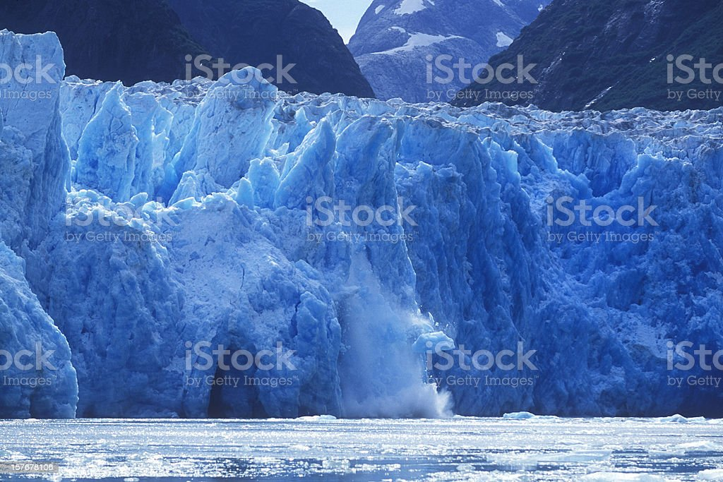 Glacier Calving into Alaskan Bay stock photo