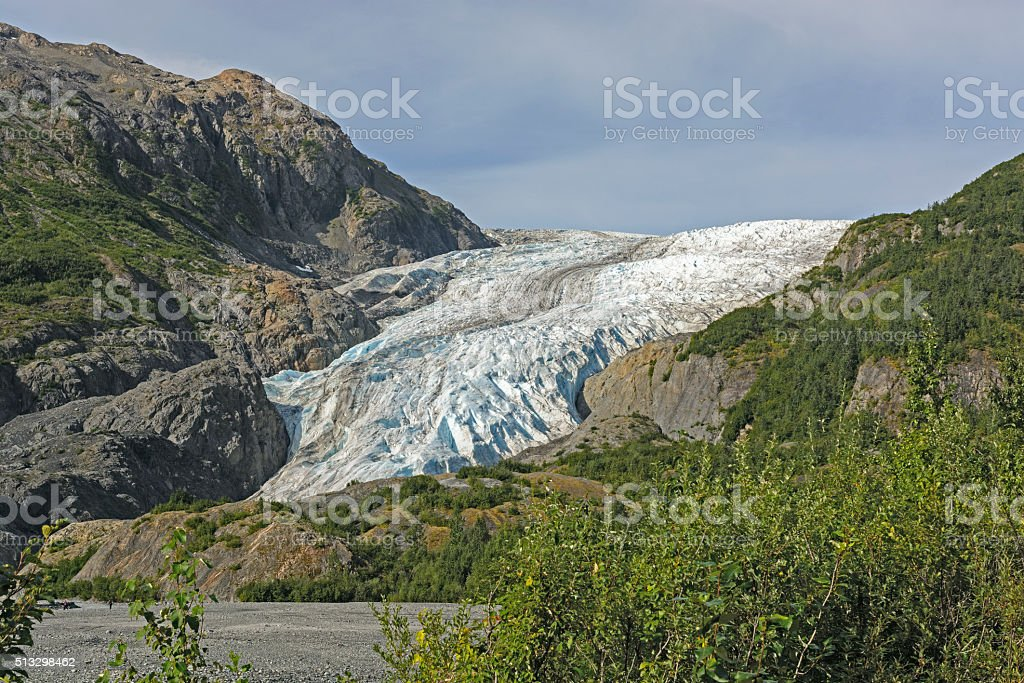 Glacier Coming out of the Mountains stock photo