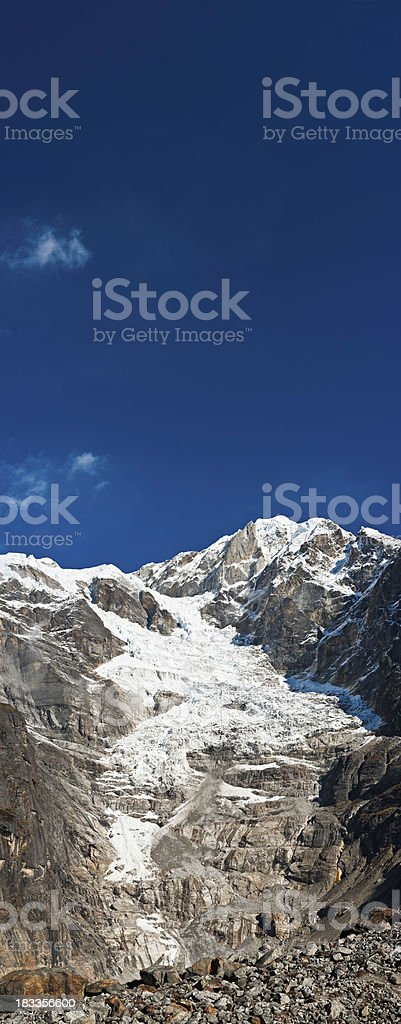 Glacier ice cascading down mountain face vertical panorama Himalayas Nepal royalty-free stock photo