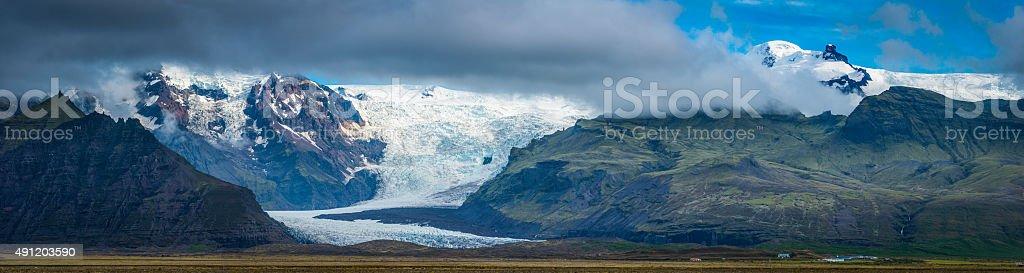 Glacier icefall tumbling down mountain to valley Hvannadalshnukur panorama Iceland stock photo