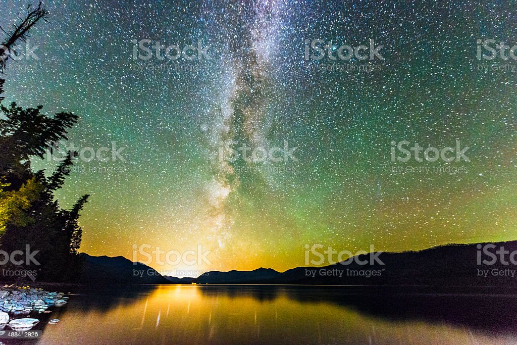 Glacier National Park Night Stars Reflection in Scenic Lake Montana stock photo