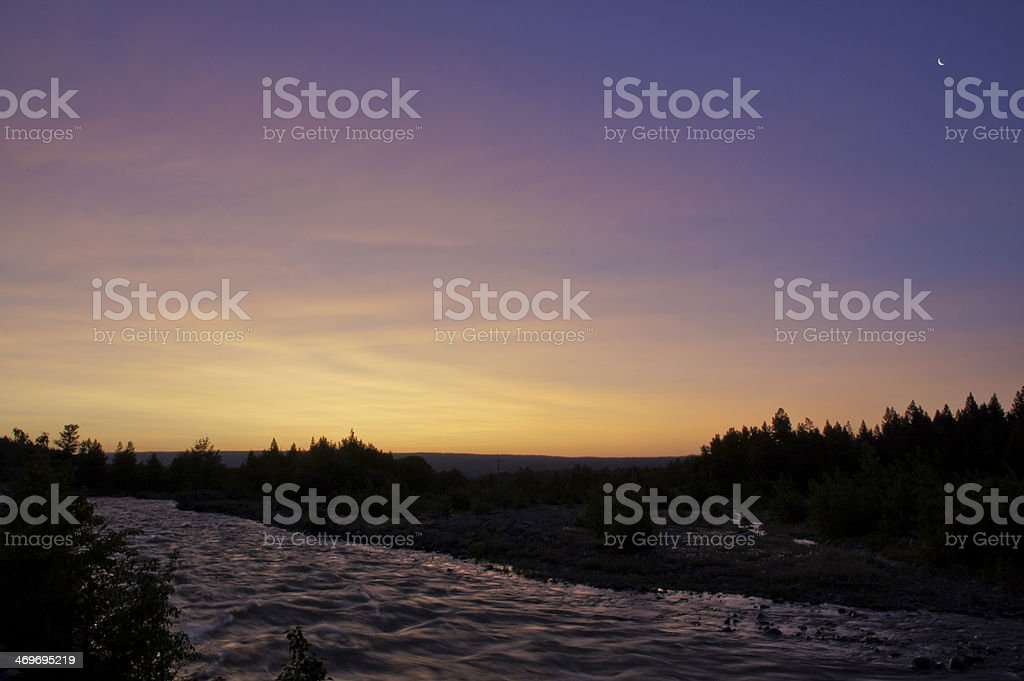 Glacier National Park Sunrise over Rapid River stock photo