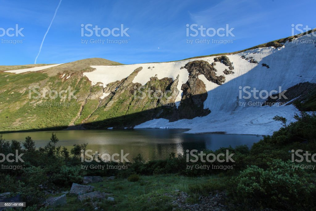 Glacier on the Ivanovskoe Lake. Kuznetskiy Alatau. Republic of Khakassia, Russia. stock photo