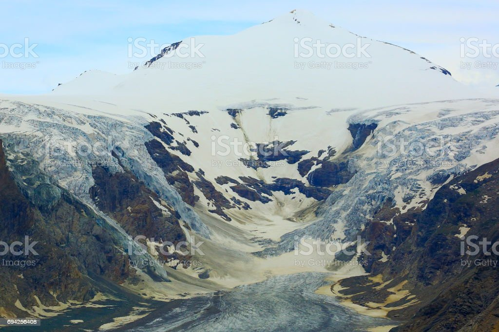 Glacier Pasterze and Hohe Tauern Snowcapped Austrian mountain range - Tirol Alps dramatic cloudscape Sky and landscape and Grossglockner Massif stock photo