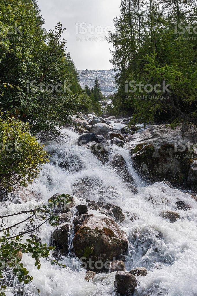 Glacier-fed stream (Bossons Glacier, Mont Blanc massif, France) stock photo