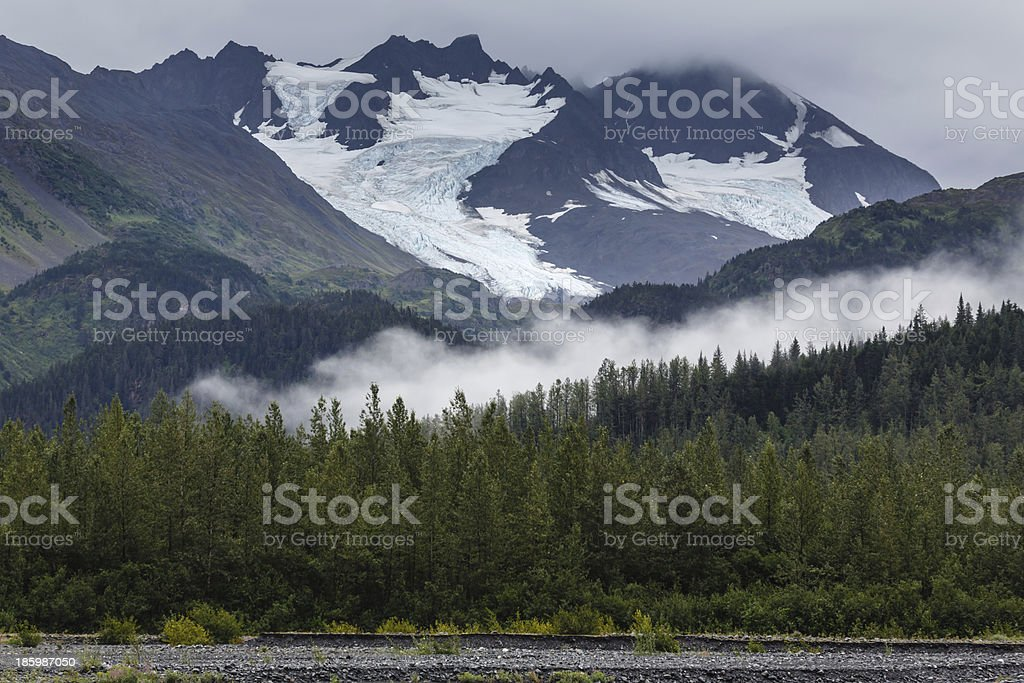 Glaciers on mountian peaks high in the clouds royalty-free stock photo