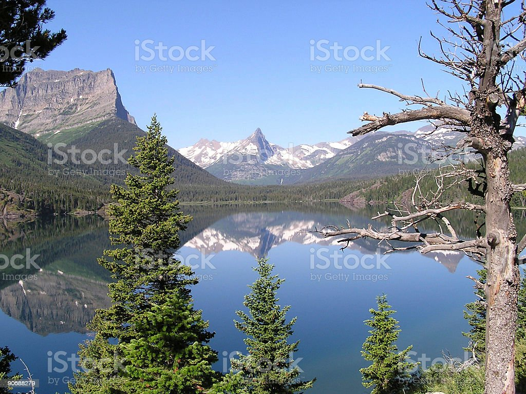Glaciers peaks reflections 2 stock photo