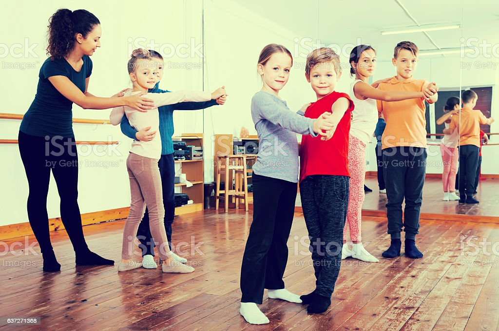 glad little boys and girls dancing pair dance stock photo