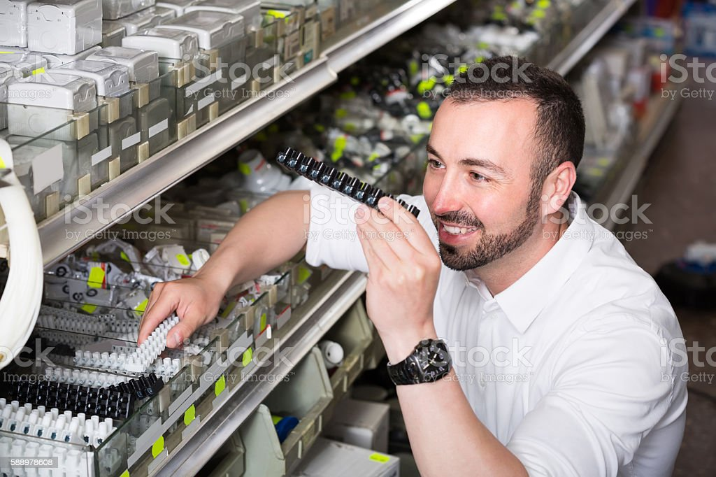 glad man picking electric plug in household shop stock photo