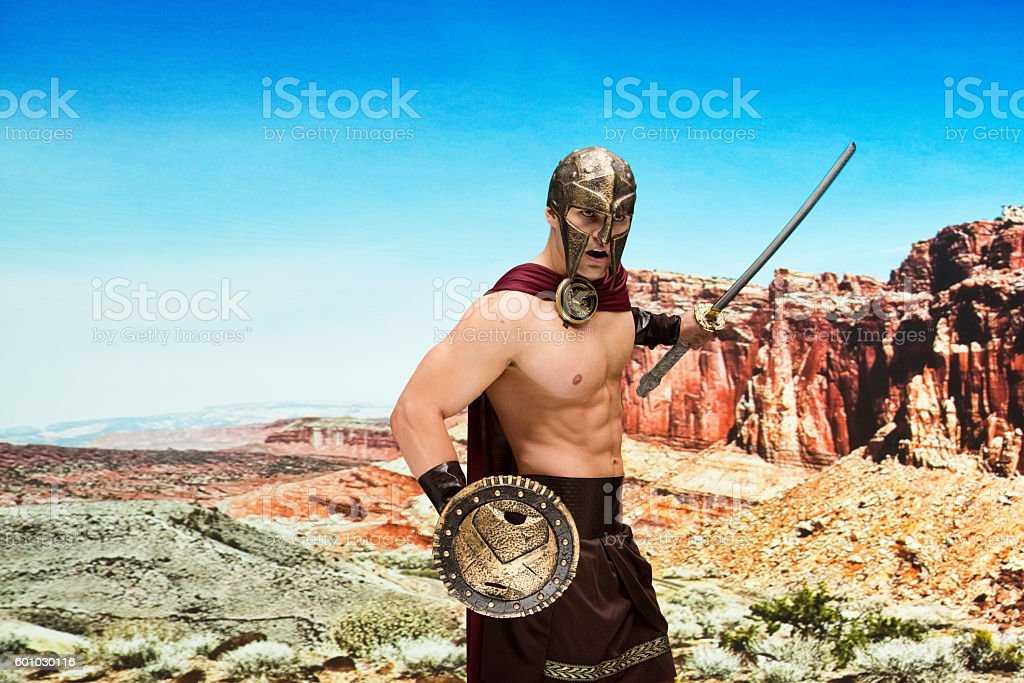 Gladiator fighting in desert stock photo