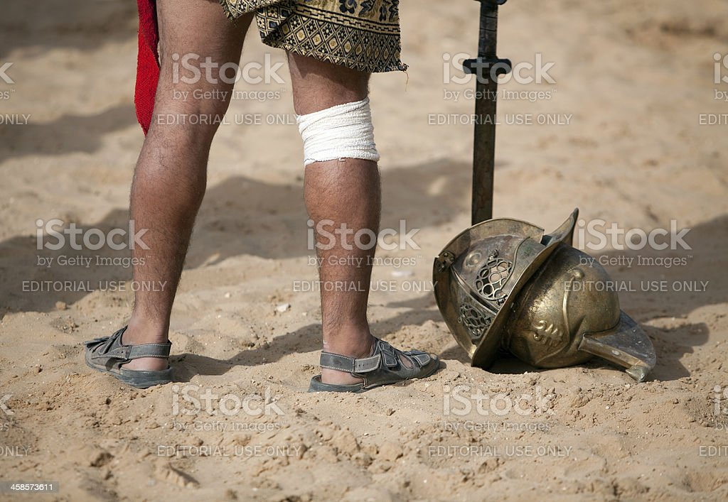 A gladiator throws his face mask on the floor after a successful...