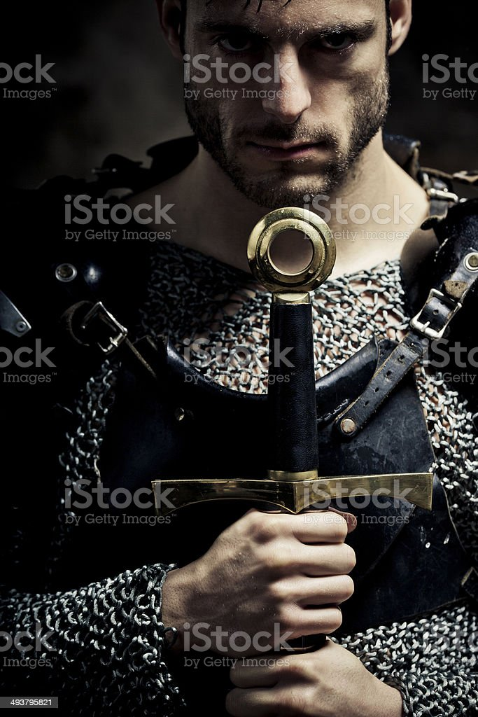 Gladiatorial looking knight in the darkness stock photo