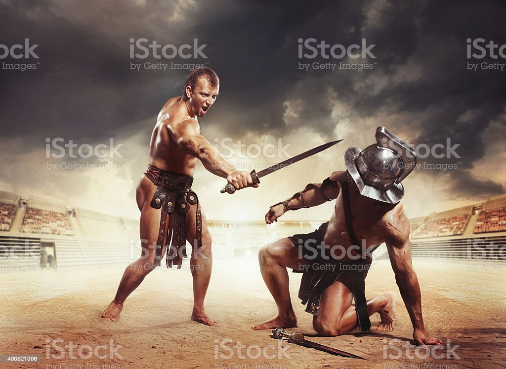Roman gladiators fighters fighting with sword at coliseum arena....