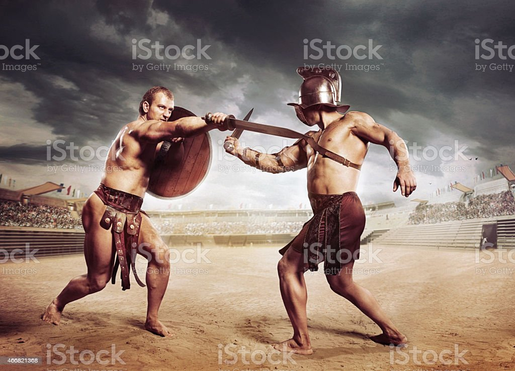 Gladiators fighting on the arena of the Colosseum stock photo