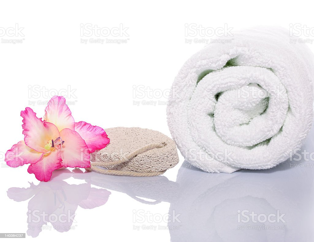 Gladiola, Towel and Pumice Rock on White Background royalty-free stock photo