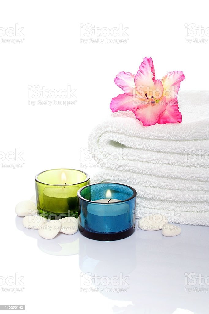gladiola, towel, candles and river stones royalty-free stock photo