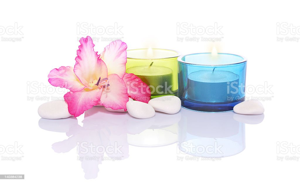 gladiola,candles and river stones royalty-free stock photo