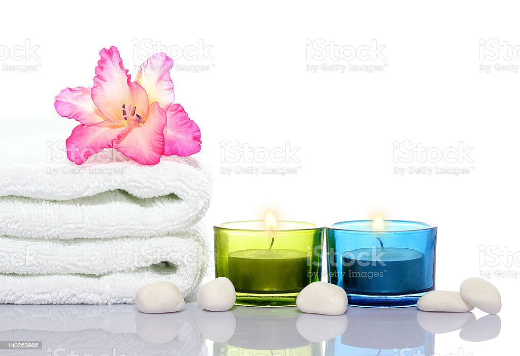gladiola,towel,candles and river stones royalty-free stock photo