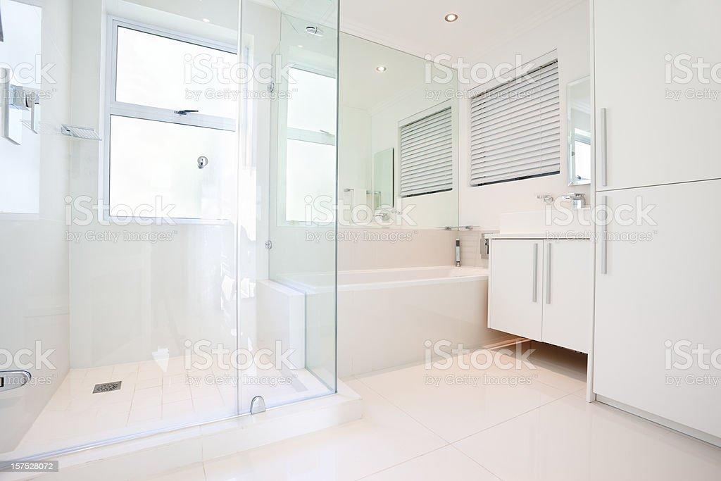 Glamorous, all white, modern bathroom royalty-free stock photo
