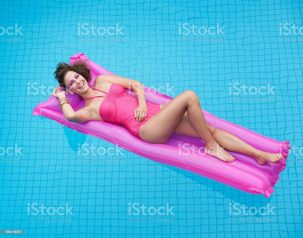 Glamorous Beauty relaxing on an Air Mattress (XXXL) royalty-free stock photo