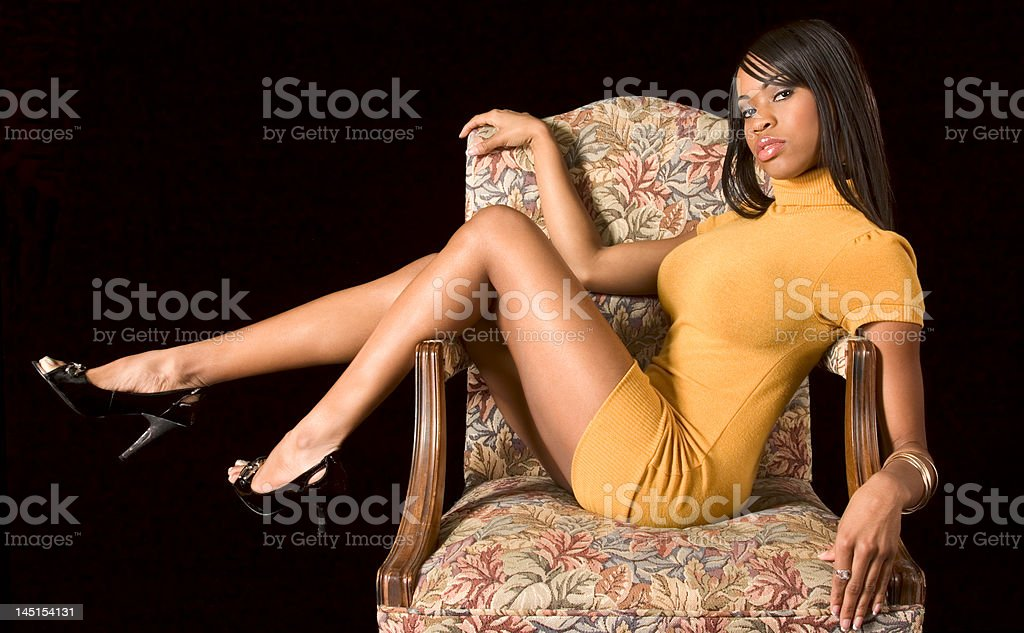 Glamorous black girl in chair royalty-free stock photo