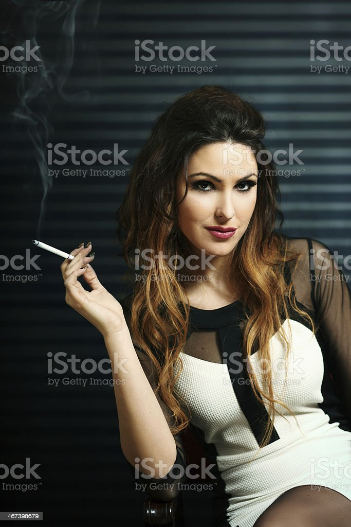 glamorous brunette with a cigarette stock photo