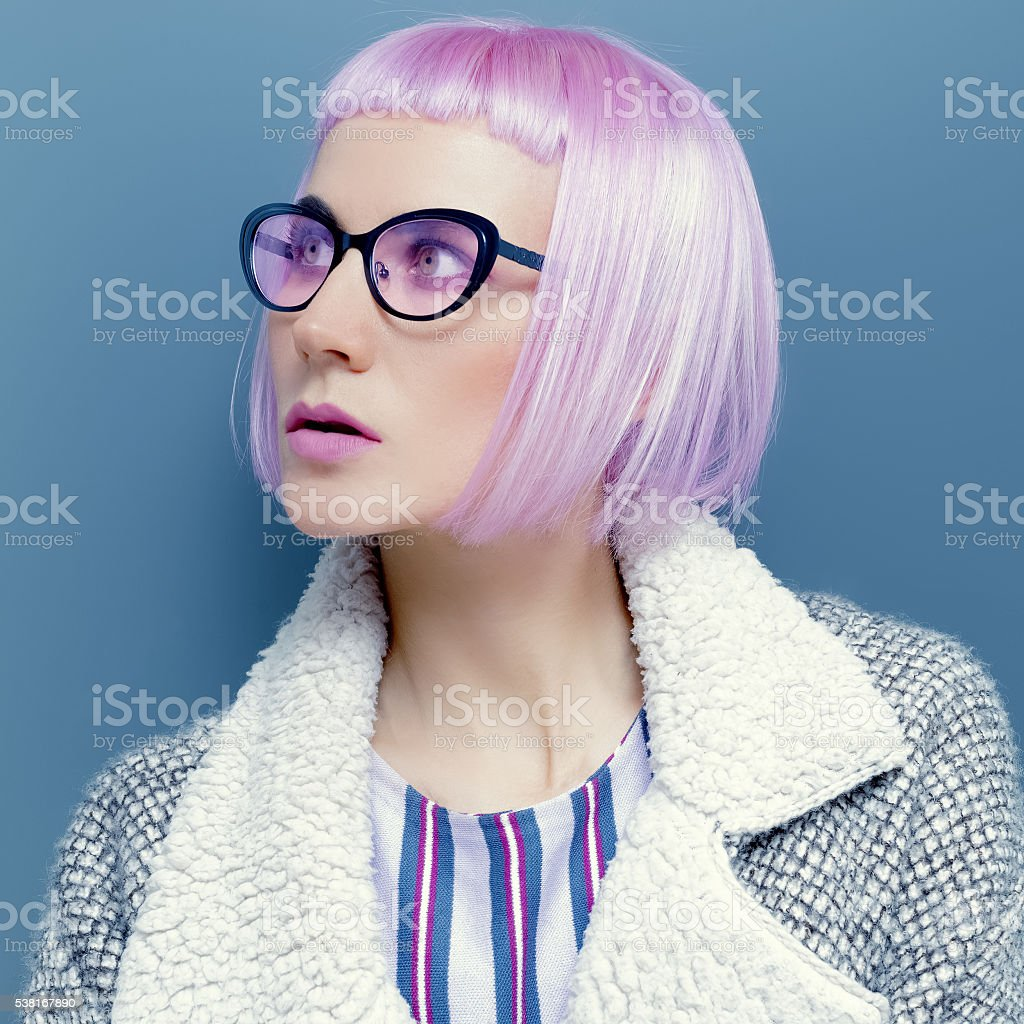 Glamorous Lady in trend glasses and pink hair. stock photo