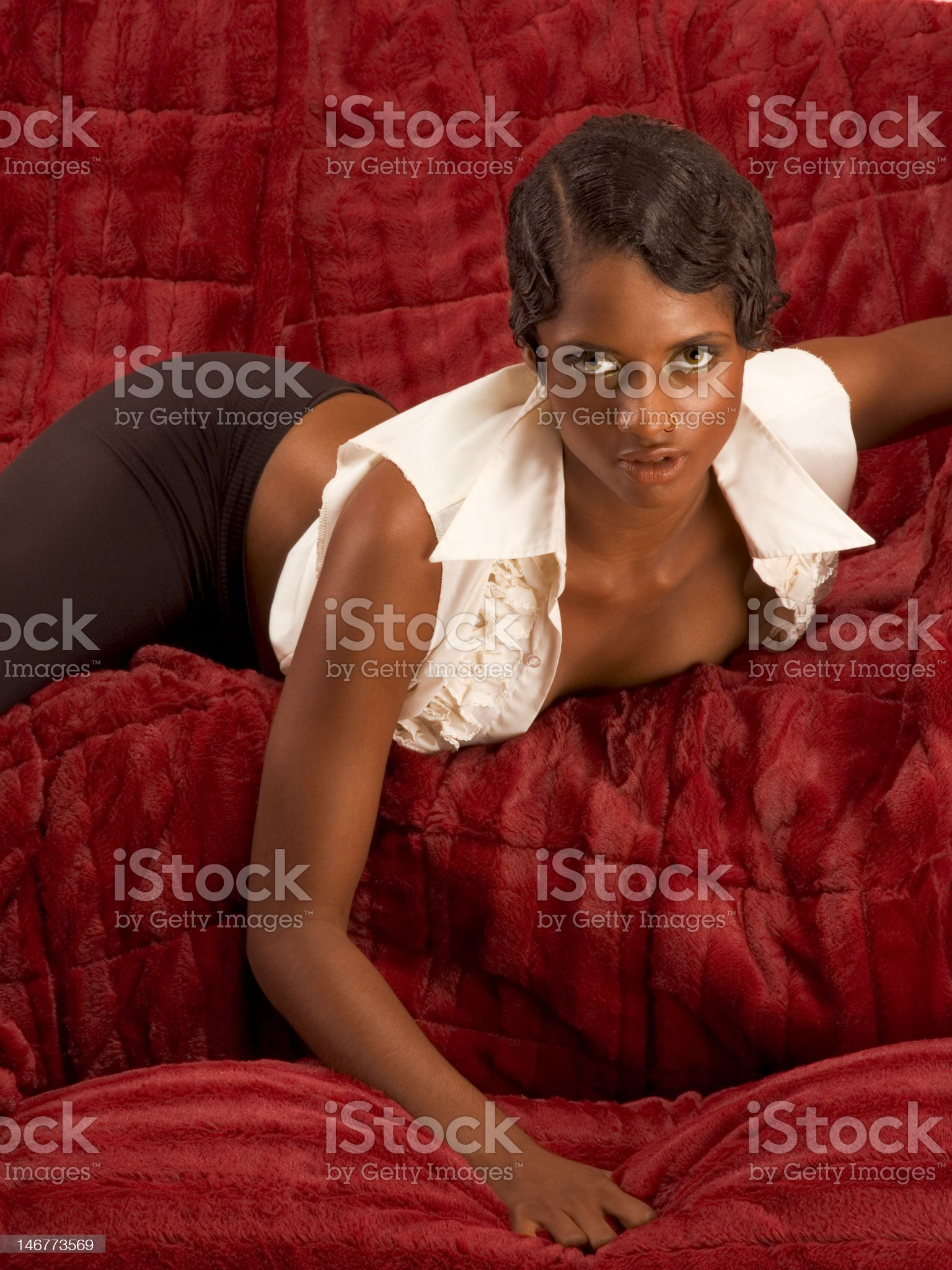 Glamorous sexy retro ethnic woman lying on couch royalty-free stock photo