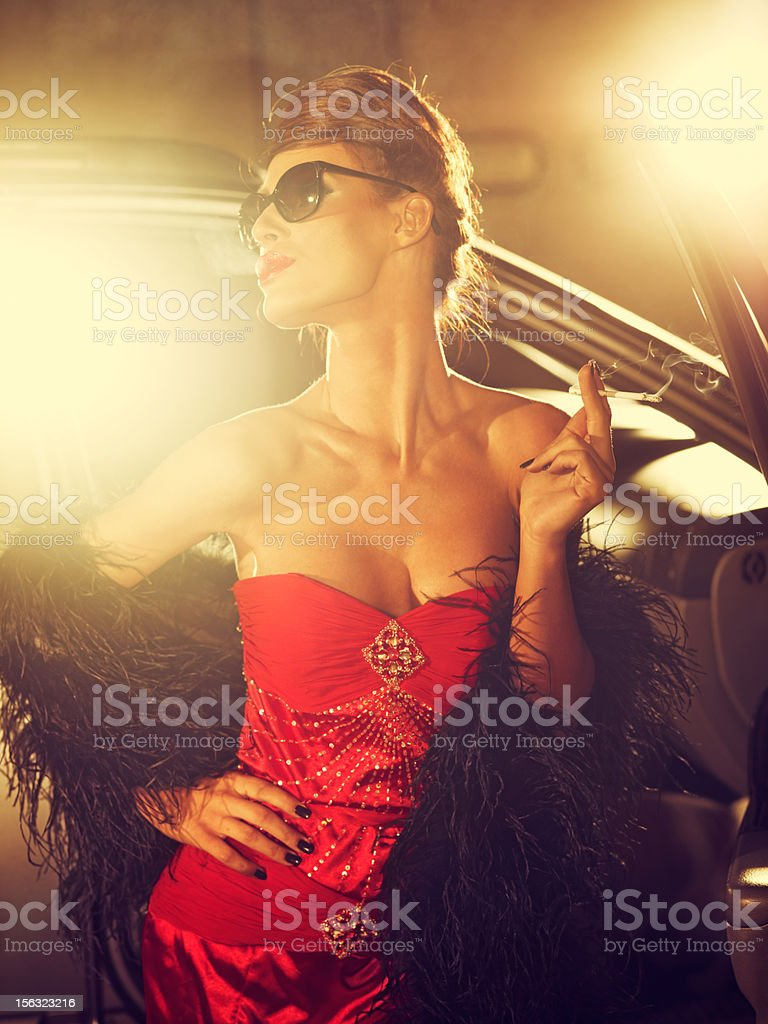 Glamorous Woman In Red Evening Gown Posing For Photographers stock photo