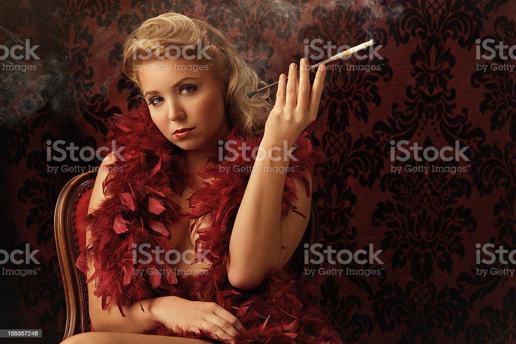 glamorous woman smoking - vintage style royalty-free stock photo