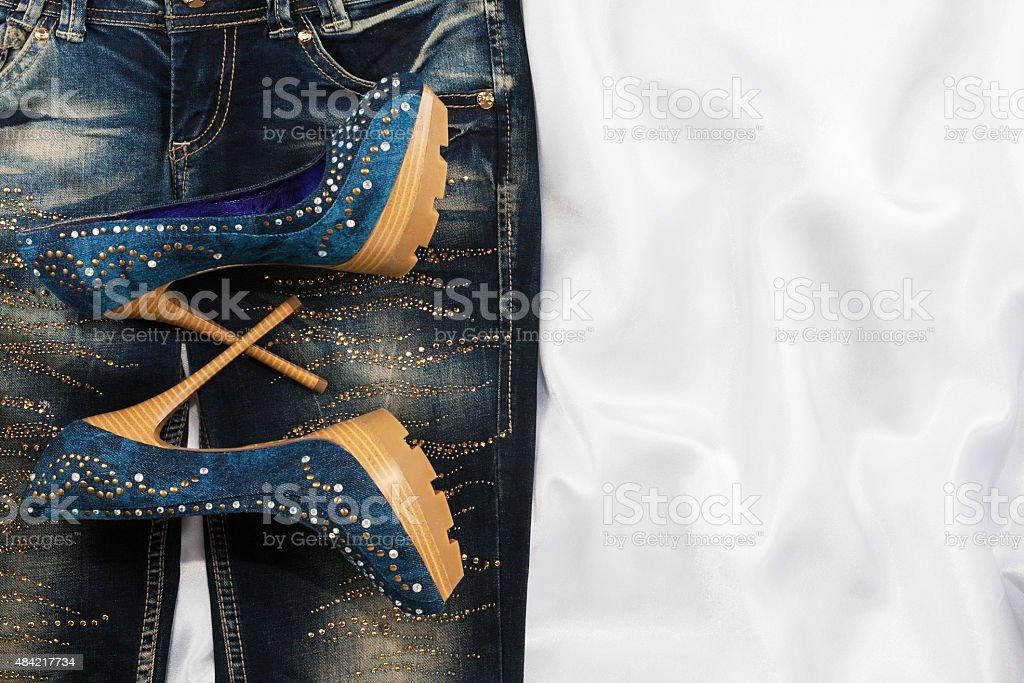 Glamorous women's fashion, jeans, shoes in rhinestones stock photo