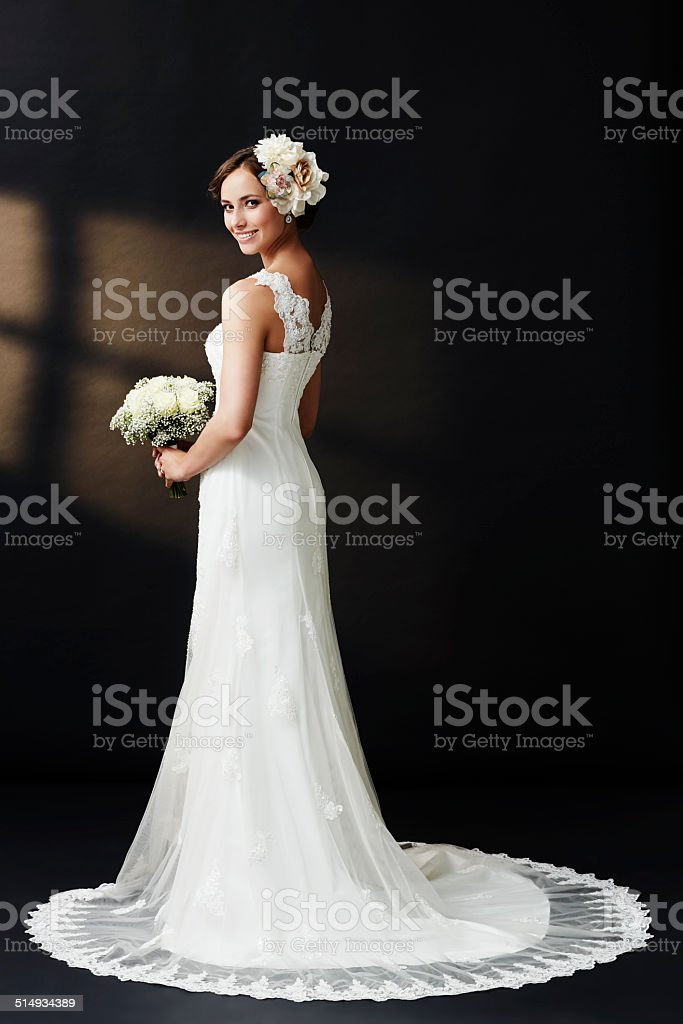 Glamorous young bride in wedding dress, smiling stock photo