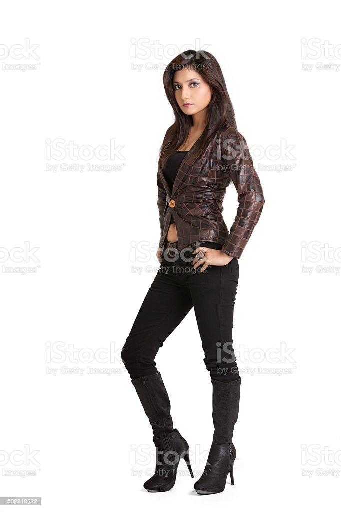 Glamorous young woman in brown leather jacket stock photo