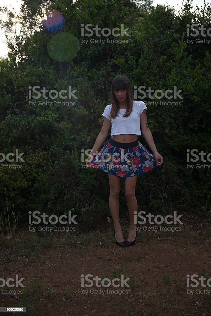 Glamour dark photo of a young girl in countryside stock photo