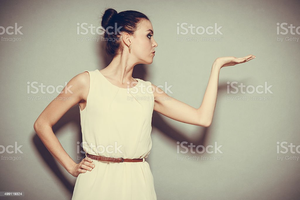 Glamour girl in bright dress on gray stock photo