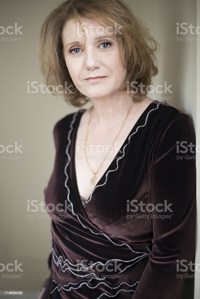 Glamour portrait of real woman in her fifties, vertical royalty-free stock photo