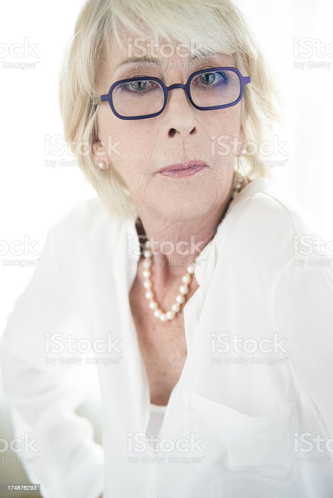 Glamour portrait of real woman in her seventies. royalty-free stock photo
