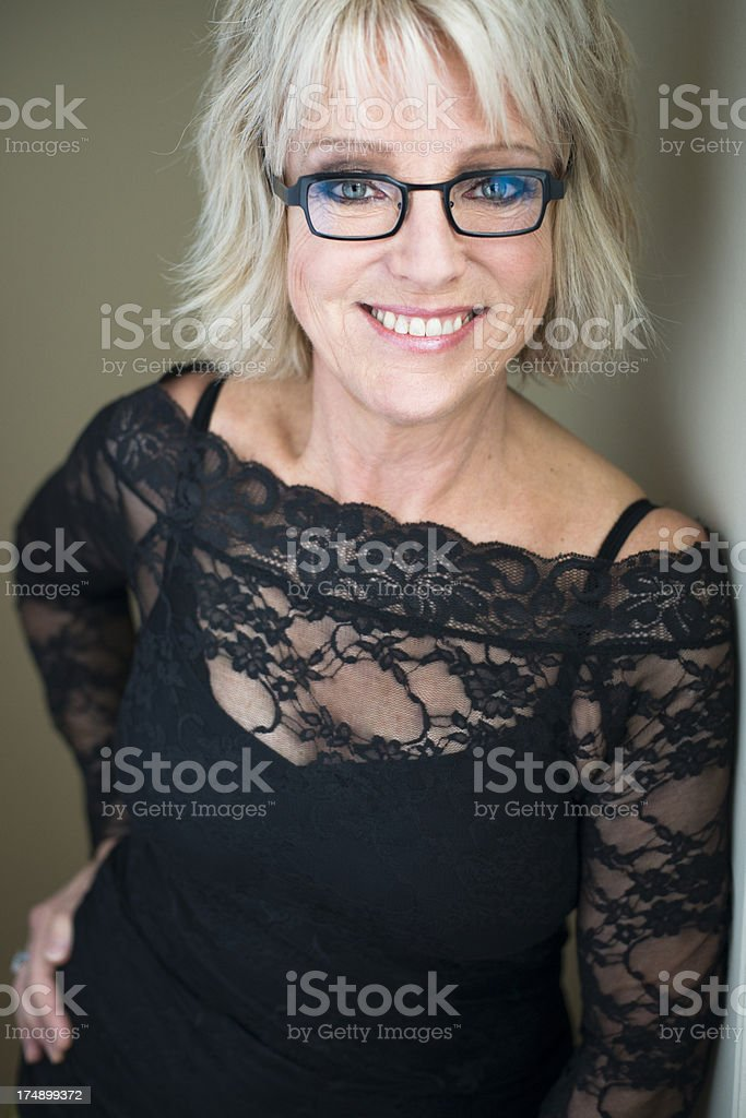 Glamour portrait of real woman in her sixties with glasses. royalty-free stock photo
