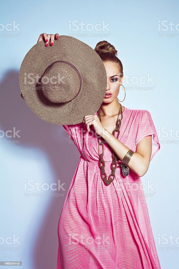 Glamour portrait of woman posing with sun hat stock photo