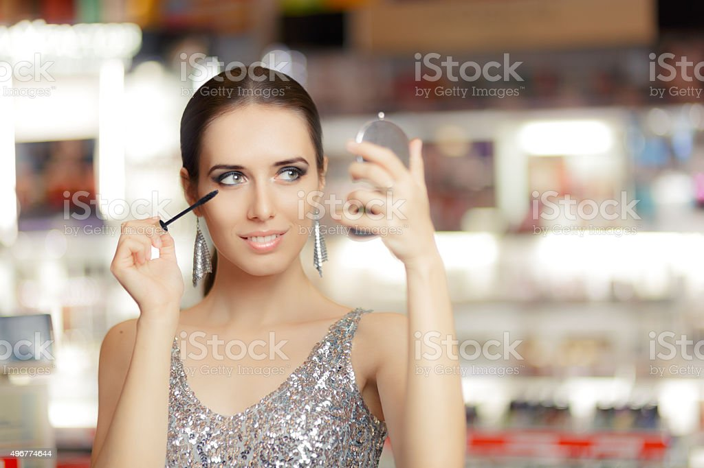 Glamour Woman with Mascara and Make-up Mirror stock photo