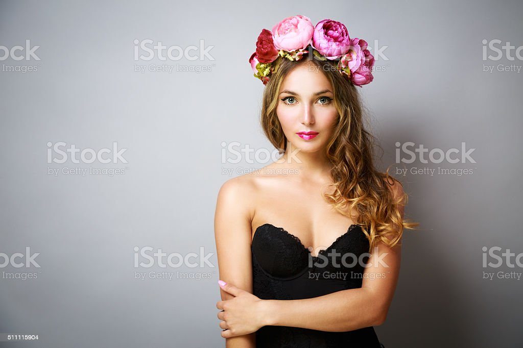 Glamour Woman with Wreath of Pink Flowers stock photo
