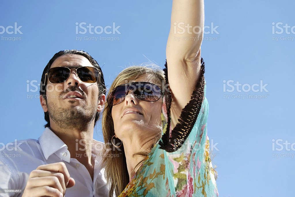 Glamourous couple looking upwards. Cannes. France stock photo