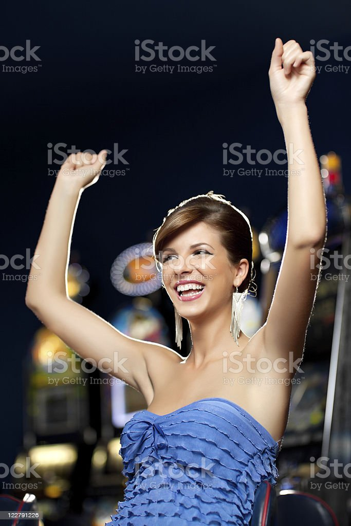 glamourous woman celebrating winning royalty-free stock photo
