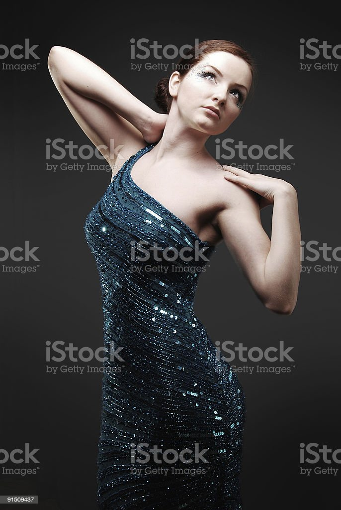 Glamourous woman in blue sparkly dress royalty-free stock photo