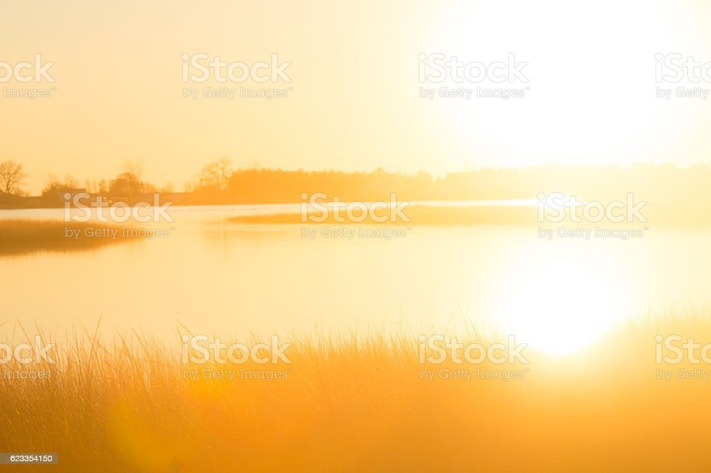 Glare of sunset over a marsh at Milford Point, Connecticut. stock photo