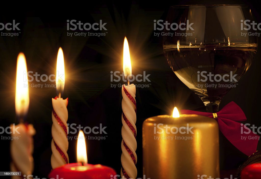 Glas with champagne and burning candles, new year ball stock photo