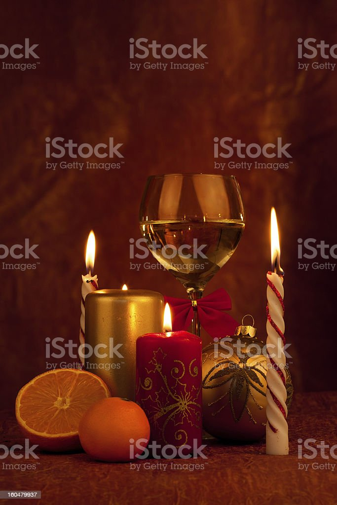 Glas with champagne and burning candles, new year ball royalty-free stock photo