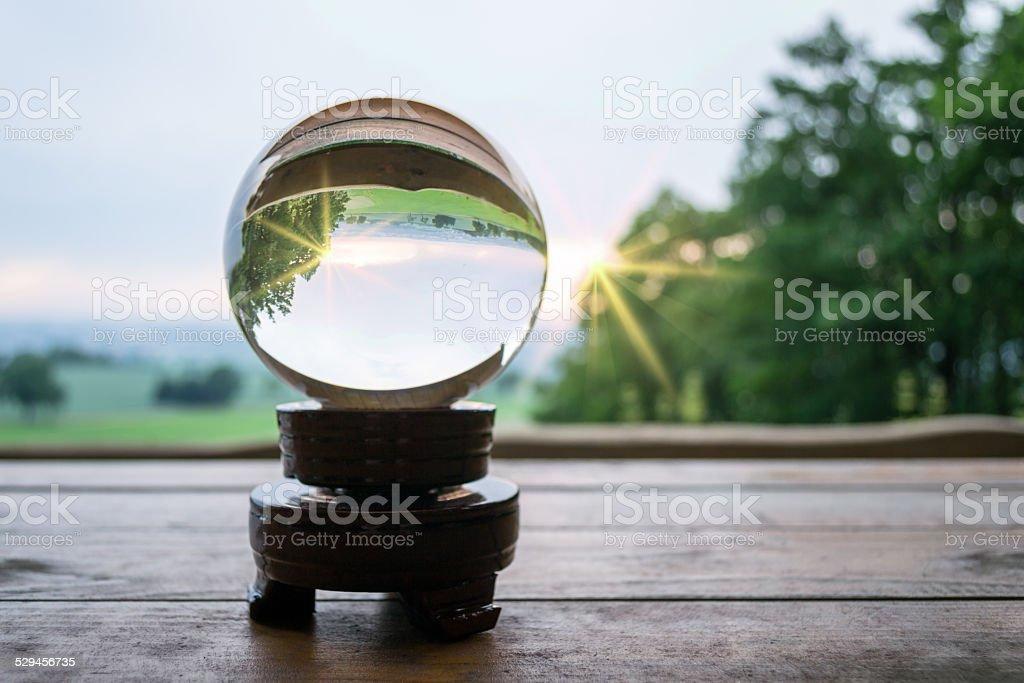 Glaskugel im Sonnenuntergang stock photo