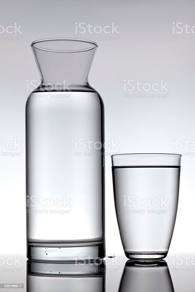 Glass and a carafe filled with water stock photo